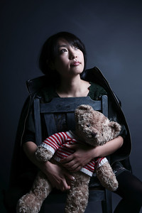 Japanese woman holding a bear